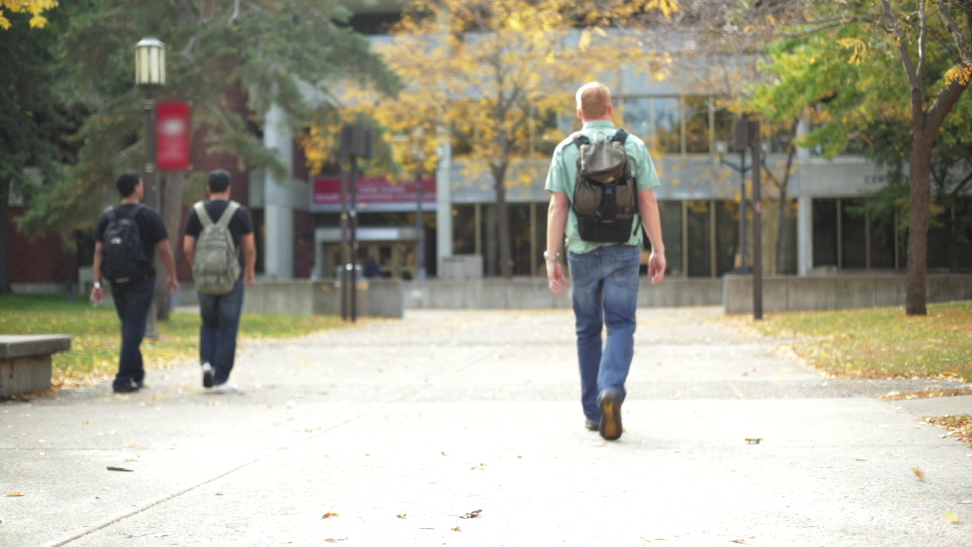 Students walking on campus sidewalk